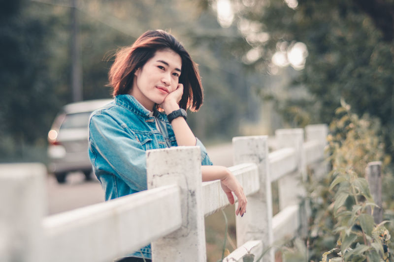 Adult Asian Teen Asian Teenager Beautiful Woman Casual Clothing Contemplation Day Emotion Front View Hairstyle Leisure Activity Looking One Person Outdoors Portrait Real People Selective Focus Smiling Standing Teenager Women Young Adult Young Women