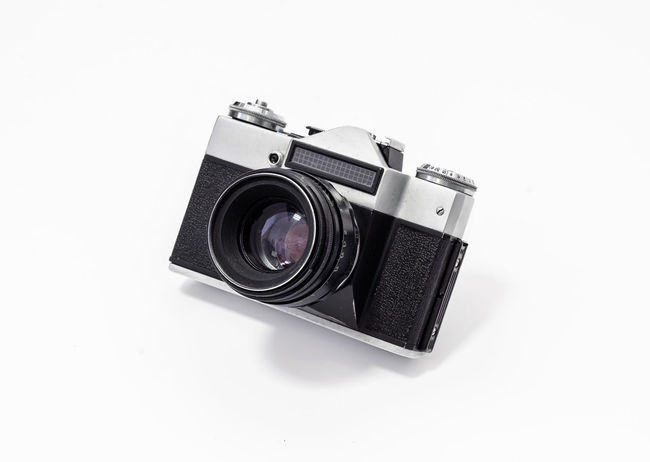 Camera - Photographic Equipment Camera Film Close-up Copy Space Cut Out Digital Camera Home Video Camera Indoors  Lens - Eye Lens - Optical Instrument No People Old Photographic Equipment Photographing Photography Themes Retro Styled Single Object SLR Camera Still Life Studio Shot Technology White Background