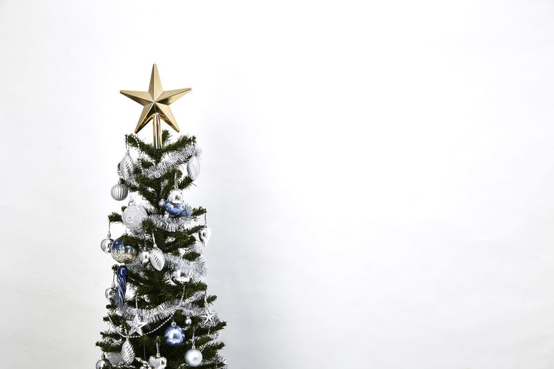 Christmas Christmas Decoration Decoration Celebration Star Shape Christmas Ornament christmas tree Holiday Copy Space No People Indoors  Holiday - Event Tree Topper Shape Ornament Celebration Event Close-up Tree Event