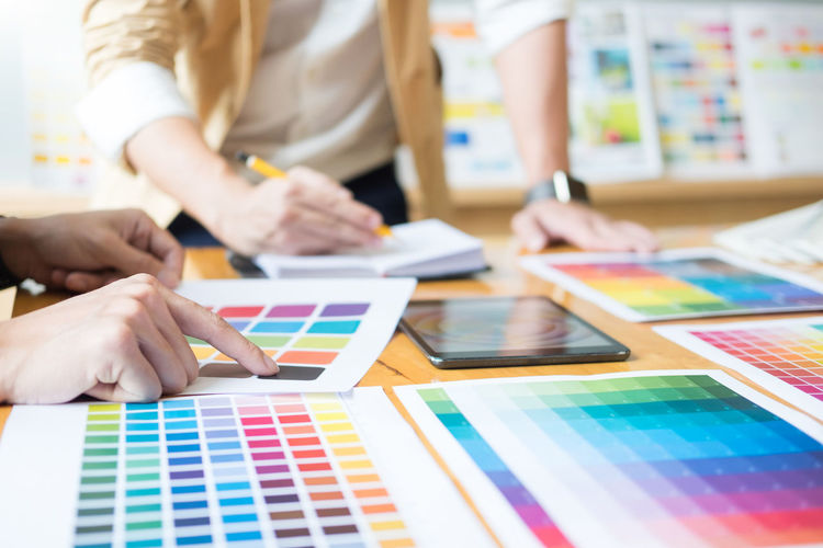 People analyzing color swatch in office