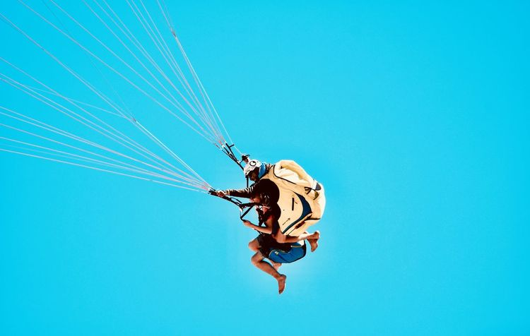 Summer Exploratorium Adventure Blue Clear Sky Copy Space Day Directly Below Extreme Sports Full Length Leisure Activity Low Angle View Men Mid-air Nature One Person Outdoors Paragliding Real People Rope Safety Harness Sky Sport