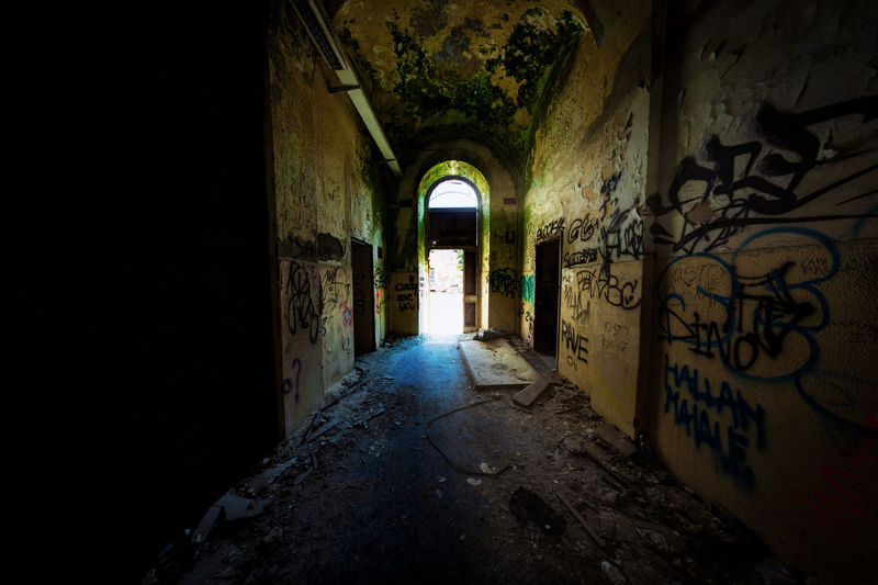 Architecture Graffiti Built Structure Indoors  Building Abandoned History No People Arch The Past Day Old Wall Direction The Way Forward Wall - Building Feature Corridor Weathered Arcade Damaged Deterioration Ceiling Ruined Mental Hospital