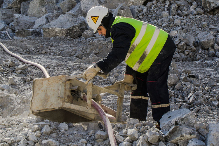 Man working on rock at construction site