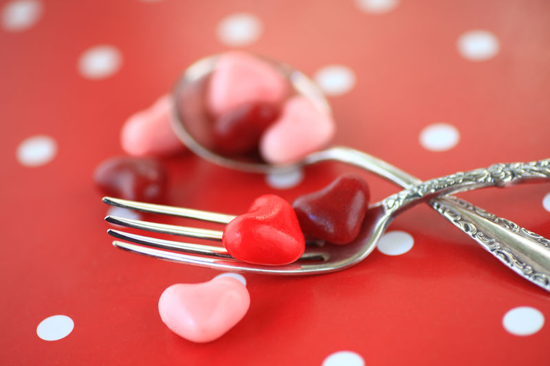 Close-up of heart shaped candies on fork