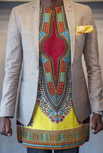 Fashion Designer African Fabric Wristwatch Blazer - Jacket Traditional Clothing Midsection Front View Real People Clothing Men Adult Standing Casual Clothing Indoors  Pattern Human Body Part Lifestyles Fashion Focus On Foreground Floral Pattern Jeans