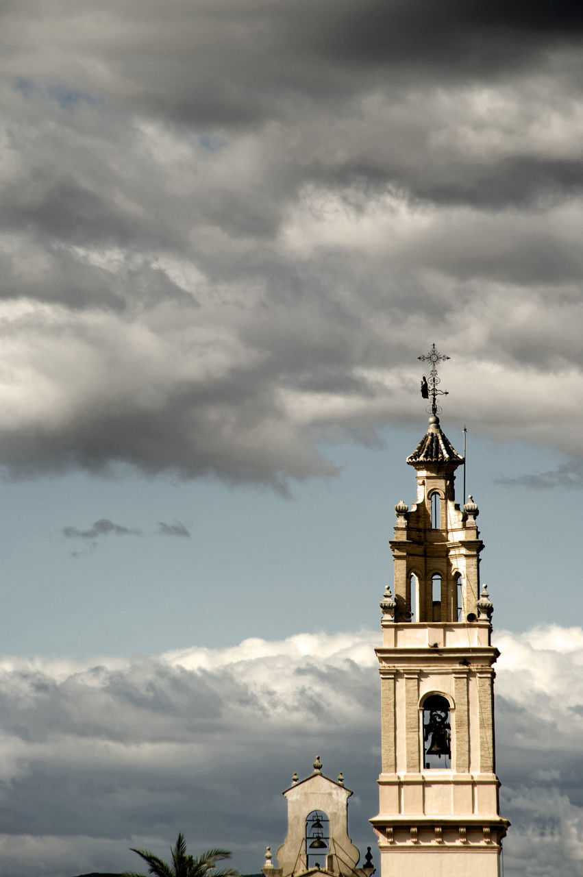 cloud - sky, sky, religion, spirituality, architecture, built structure, place of worship, building exterior, no people, bell tower, day, outdoors, cross, low angle view, nature