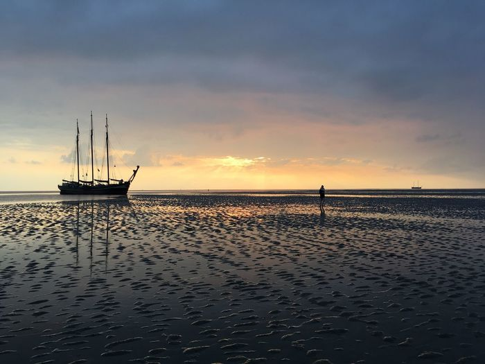 People And Places Horizon Over Water Sea Wattenmeer Wattwanderung Beauty In Nature Holland Water Sunset Tranquil Scene Scenics Tranquility Rippled Sky Orange Color Calm Cloud Nature Waterfront Cloud - Sky Seascape Dramatic Sky Ocean Majestic First Eyeem Photo