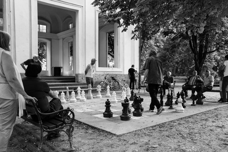 Adult Building Exterior Chess Chess Board Chess Piece Competition Day Knight - Chess Piece Leisure Activity Leisure Games Lifestyles Men Outdoors People Playing Queen - Chess Piece Real People Sitting Strategy The Street Photographer - 2017 EyeEm Awards