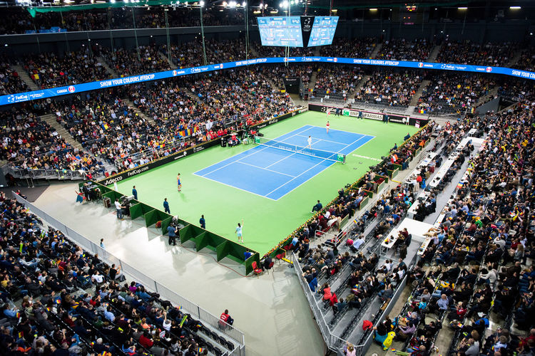 High Angle View Of Crowd At Tennis Court