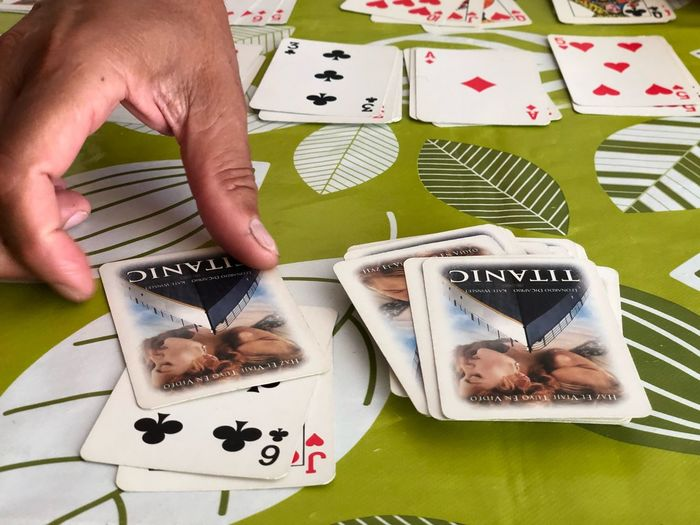 Titanic RummyNight Rummy One Person Human Body Part Human Hand Hand Leisure Activity Holding High Angle View Arts Culture And Entertainment Relaxation Leisure Games Real People Gambling Creativity Body Part Cards Close-up Finger