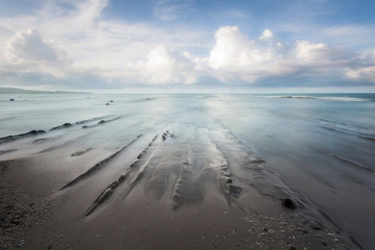 Beach walk. ocean view. long exposure capture of coast and ocean on borneo, sabah - malaysia