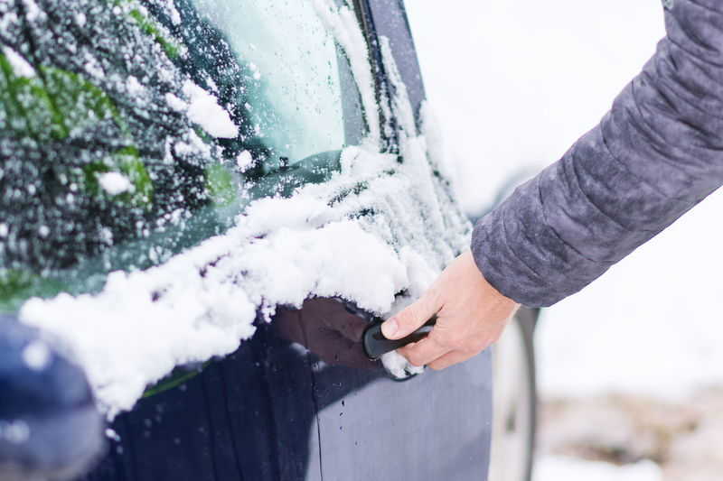 Close up view of hand unlocking frozen car lock at cold winter day. Body Part Cold Temperature Day Finger Focus On Foreground Hand Holding Human Body Part Human Hand Lifestyles Midsection Nature One Person Outdoors Real People Snow Snowing Standing Warm Clothing Winter