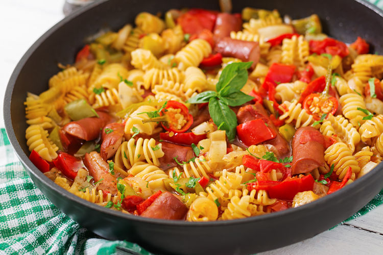 Close-up of pasta in saucepan on table