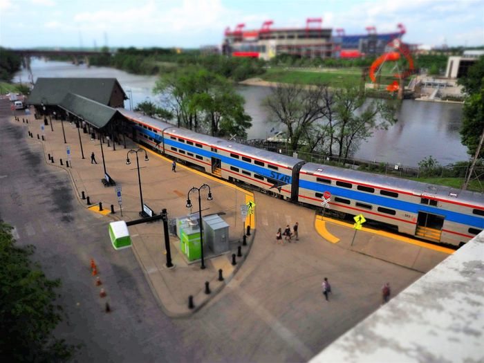 High angle view of train by river in city