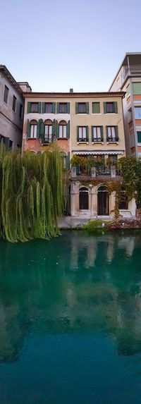 Building Exterior Architecture Water Canals Built Structure Outdoors Day House Façade Travel Destinations Vacations City Trees Willows Reflections And Shadows