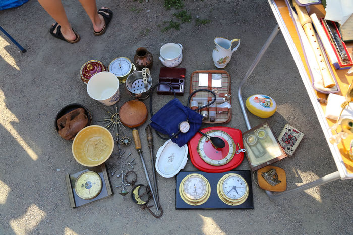 Asphalt Road Asphalt Street Bowl Clock Close-up Day Details Fleamarket High Angle View Kitchen Utensil Kitchen Utensils Marketplace Numbers One Person Outdoors People Plate Porcelain  Real People Sitting Street Table Things Urban Utensils