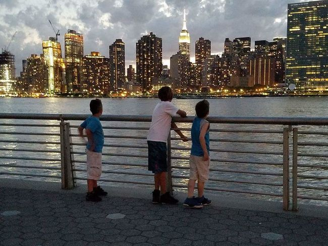 When your Kids Live In the Rich kids Generation and are Blessed  Skyscraper Child Togetherness Childhood Boys City Children Only City Life Urban Skyline Cityscape Rear View People Full Length Cloud - Sky Building Exterior Architecture Standing EyeEm Vision Sky