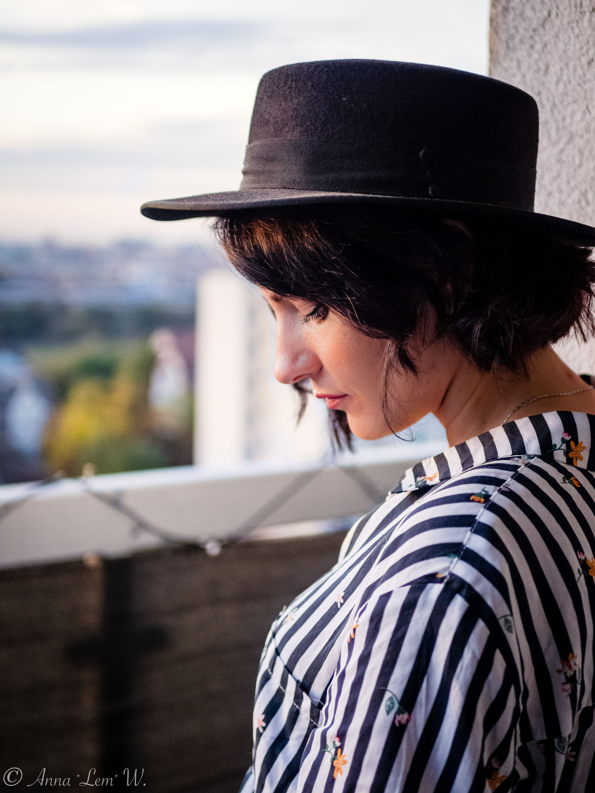 hat, clothing, one person, real people, lifestyles, leisure activity, young adult, young women, adult, women, focus on foreground, portrait, headshot, looking, casual clothing, striped, side view, looking away, day, beautiful woman, hairstyle
