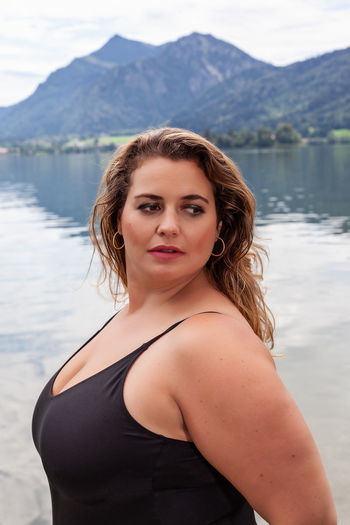 Portrait of young woman in lake
