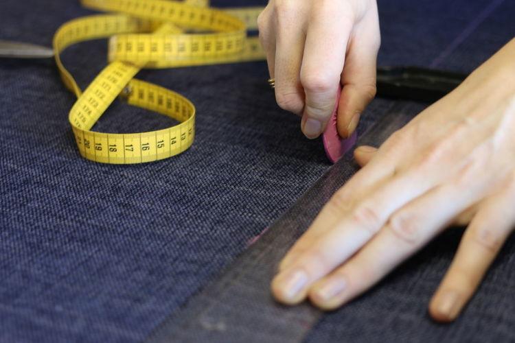 Cropped image of dressmaker at work