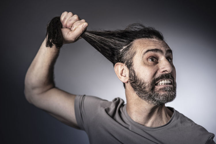 Hair Hold Man Caucasian Anger Rage Expression Face Angry Portrait Adult Aggressive Scream Male Concept Fury Stress Crazy Cry Shout Studio Casual Yell Emotion Negative Upset Furious Bad Frustration HEAD Gesture Frustrated Mad Irritated Psycho Expressions Rampage