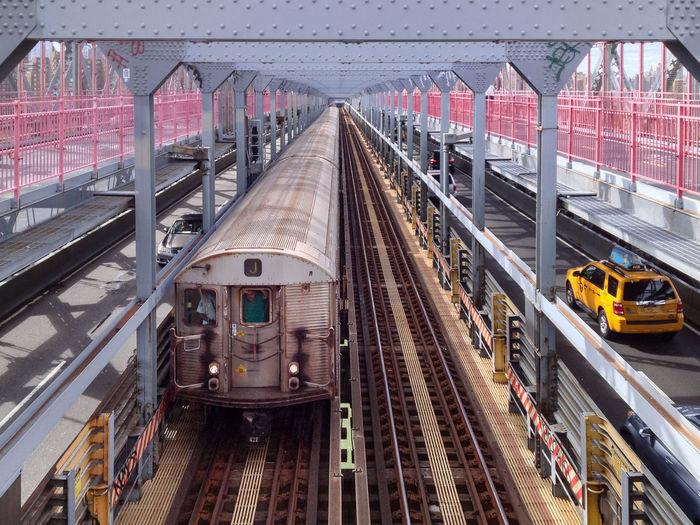 Train amidst roads on bridge