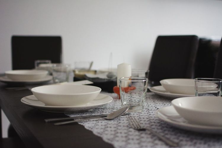Close-up of arranged dining table