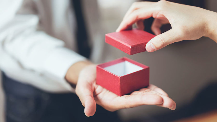 Man holding open the empty red gift box. Human Hand Hand Human Body Part Holding Red Gift Box Ribbon Ribbon - Sewing Item Box - Container Real People Indoors  Close-up One Person Emotion Container Women Body Part Gift Box Finger Human Limb