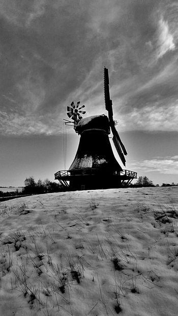 Historical Building Windmill Blackandwhite Sky And Clouds Snow