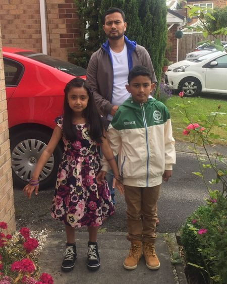 Adam Miah Amelia Miah Car Looking At Camera Transportation Full Length Real People Standing House Smiling Front View Land Vehicle Father Portrait Driveway Togetherness Outdoors Cheerful Mode Of Transport Family Lifestyles Elementary Age