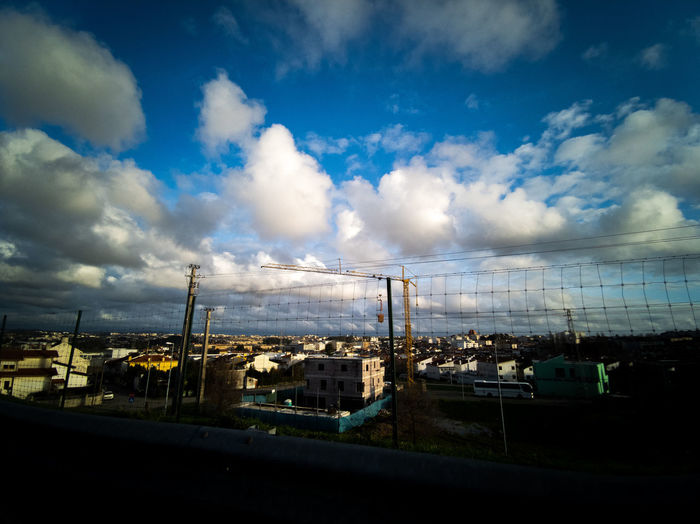 Panoramic view of factory against sky