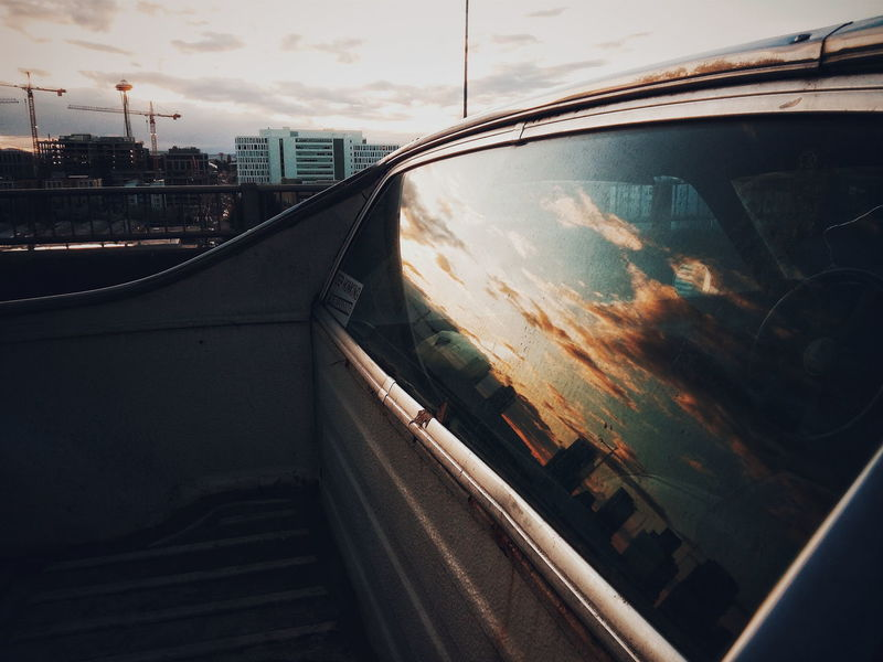 Hanging Out Reflection Taking Photos Sunset EyeEm Gallery Streetphotography Light And Shadow The Week Of Eyeem Discover Your City Seattle Skyline El Camino Car Automobile EyeEm Best Shots Urban Lifestyle Cityscape