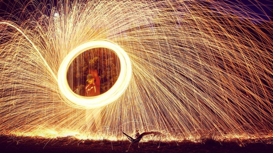 Blurred motion of man with sparklers