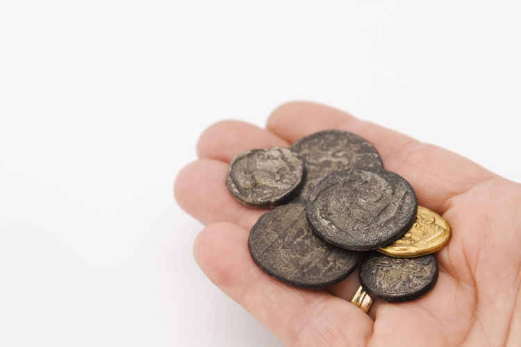 Close-up of hand holding coins