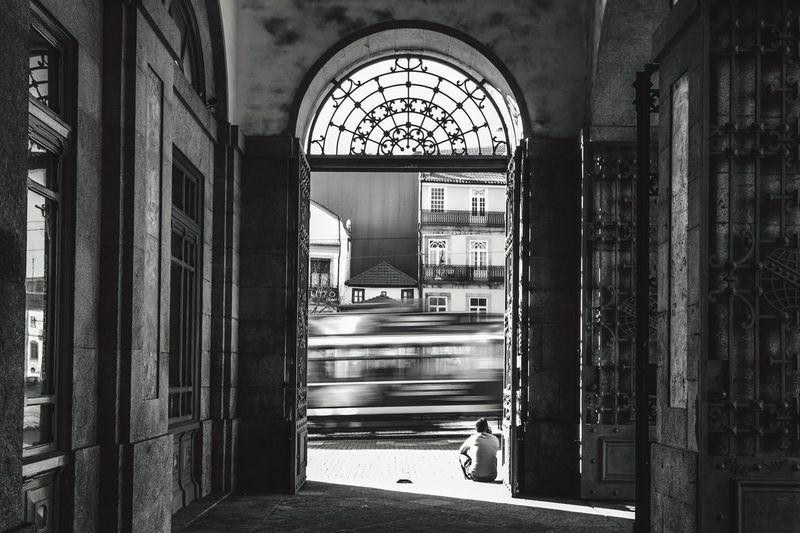 Train Viewed Through Archway