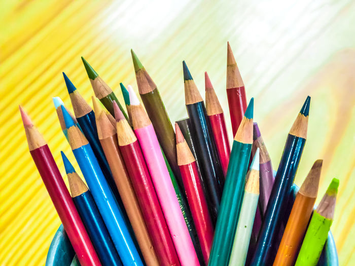 Multicolored pencils are combined in a steel box on a desk in the office. Art Background Blue Bright Brown Closeup College Color Colored Colorful Colors Colour Concept Crayon Crayons Creative Design Draw Drawing Education Equipment Frame Green Group Image Isolated Macro Object Office Orange Paint Palette Pen Pencil Pencils Rainbow Red Row School Set Sharp Stationery Supplies Up Variation Vector White Wood Wooden Yellow Multi Colored Writing Instrument Art And Craft Choice Still Life Large Group Of Objects Close-up No People Colored Pencil Indoors  Craft Art And Craft Equipment Creativity High Angle View Side By Side Wood - Material Vibrant Color Selective Focus Variety