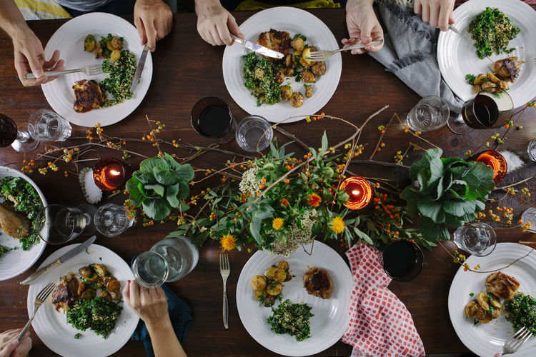 Overhead shot of a dinner party Dining Dinner Dinner Party Domestic Life Eating First Eyeem Photo Food High Angle View Indoors  Lifestyles Meal Plate Table Fresh On Market 2017