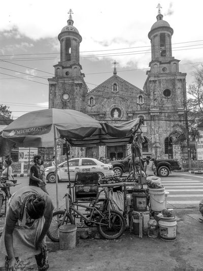 Sunday on a busy street somewhere in the Visayas Philippines. Outdoors Place Of Worship Real Streetphotography_bw EyEmNewHere Lenseculture Streetphotographyphilippines Blackandwhitephoto Real People EyeEmGalley The Street Photographer - 2017 EyeEm Awards The Street Photographer - 2017 EyeEm Awards