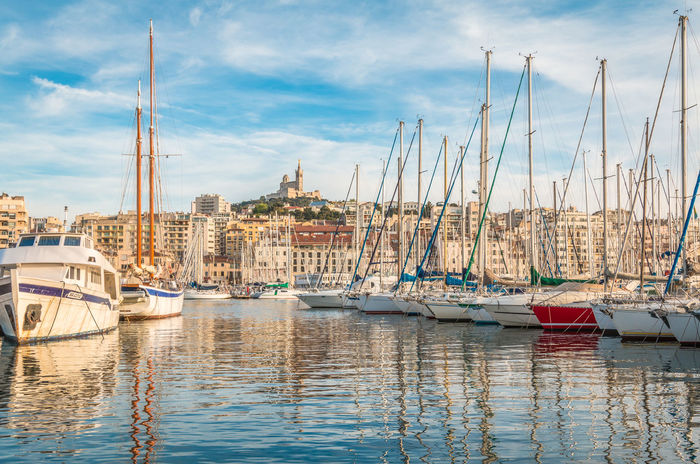 Vieux Port in Marseille France France Marseille Anchored Architecture Building Exterior Built Structure City Cityscape Cloud - Sky Harbor Marina Mast Mode Of Transportation Moored Nature Nautical Vessel No People Outdoors Pole Reflection Sailboat Sea Sky Transportation Vieux Port De Marseille Vieux Port De Montréal Water Waterfront Yacht
