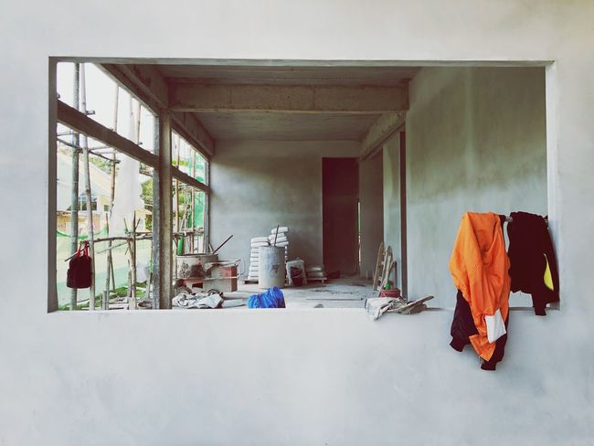 Perspective view of under-construction site Home Monney Contractor New House Dusty Wooden Scaffolding Cement Bags Construction Work Working Site Plastering Cement Wall Indoors  Architecture No People Day