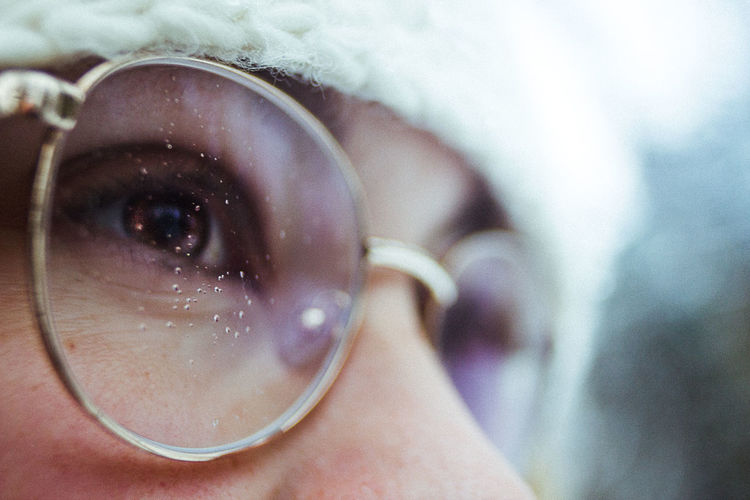 Extreme close-up of woman wearing eyeglasses while looking away outdoors