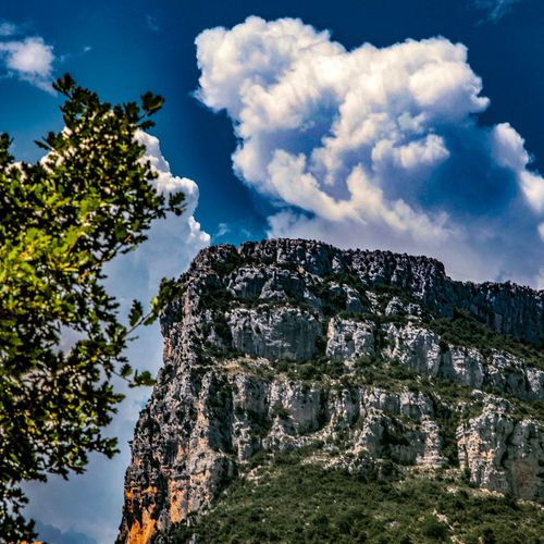 BETWEEN ROCKS AND CLOUDS Sky Cloud - Sky Tree Plant Architecture Nature Low Angle View History No People Beauty In Nature Outdoors Tranquility EyeEmNewHere
