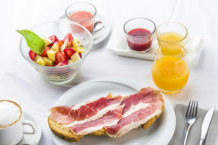Meat And Fruit Salad With Juice Served On Table