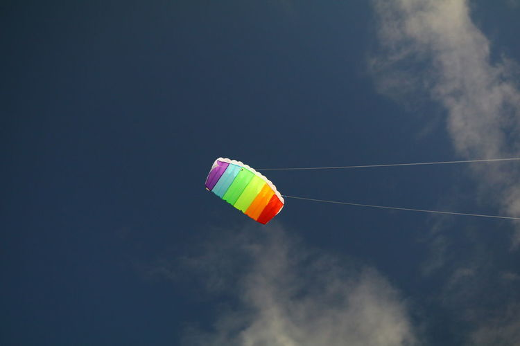 Adventure Cloud - Sky Day Extreme Sports Flying Kite - Toy Leisure Activity Low Angle View Mid-air Multi Colored Nature No People Outdoors Parachute Paragliding Sky Vapor Trail