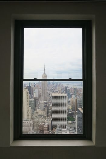 Modern Cityscape Against Sky Seen Through Window