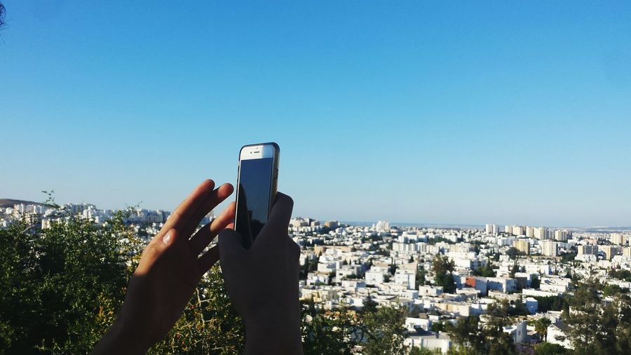 Smart Phone Portable Information Device Wireless Technology Human Hand Cityscape Architecture City Mobile Phone Sky Photographing Human Body Part Outdoors One Person Photography Themes Adult Day People Adults Only Tunis Tunisia The Architect - 2017 EyeEm Awards The Great Outdoors - 2017 EyeEm Awards EyeEm Selects Be. Ready. AI Now The Great Outdoors - 2018 EyeEm Awards My Best Photo Humanity Meets Technology