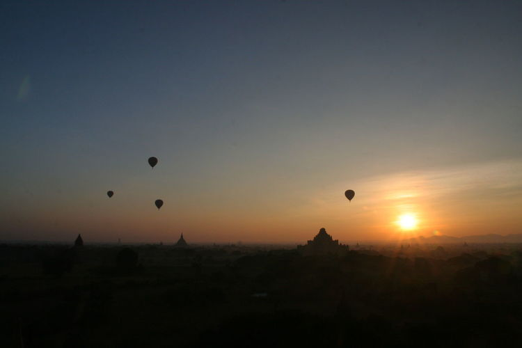 Silhouette of hot air balloon against sky during sunset