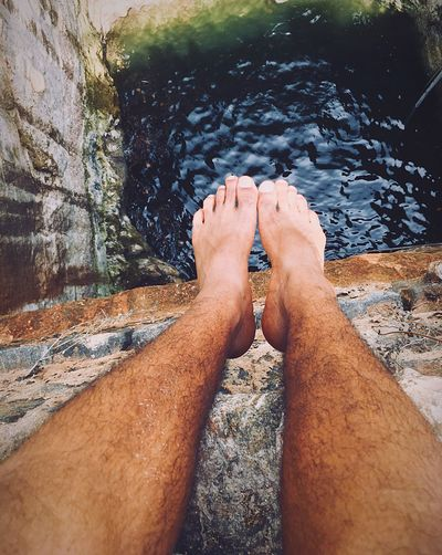 Thinking whether to jump or not 🤔. rRock - ObjectpPersonal PerspectivedDaylLakehHuman Body PartnNatureoOutdoorsmMenoOne PersonrReal PeoplerRock ClimbingoOne Man OnlysSwimmingaAdultpPeopleoOnly MenhHuman HandcClose-uplLegs_onlyHHairfFromtop