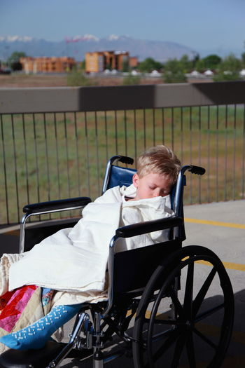 Boy Sleeping In Sitting On Wheel Chair