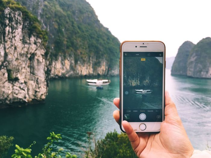 Love the view at Halong Bay Vietnam Mobile Phone Wireless Technology Portable Information Device Smart Phone Communication Holding Photo Messaging Photographing Photography Themes Technology Sea Digital Viewfinder Human Hand Using Phone Eye4photography  Iphonephotography Eyeemphotography Outdoors EyeEm Gallery Halong Bay Vietnam